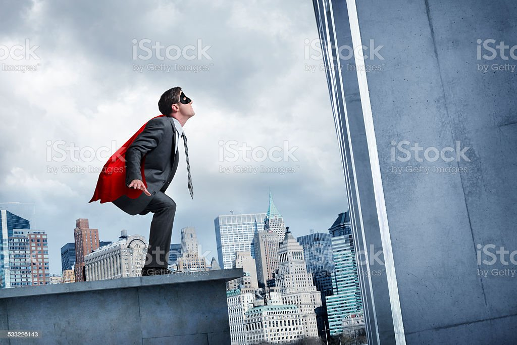 Businessman About To Leap Tall Buildings stock photo
