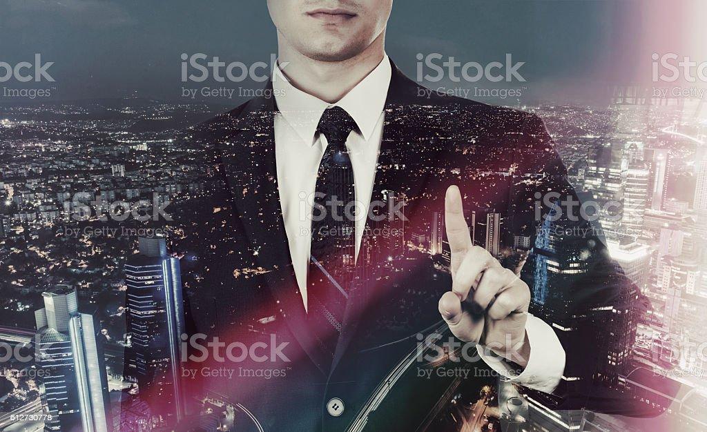 Businessman above city stock photo
