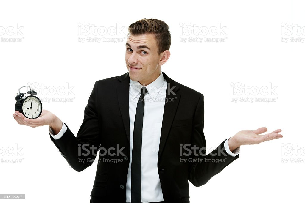 Businessman acting confused about the time stock photo