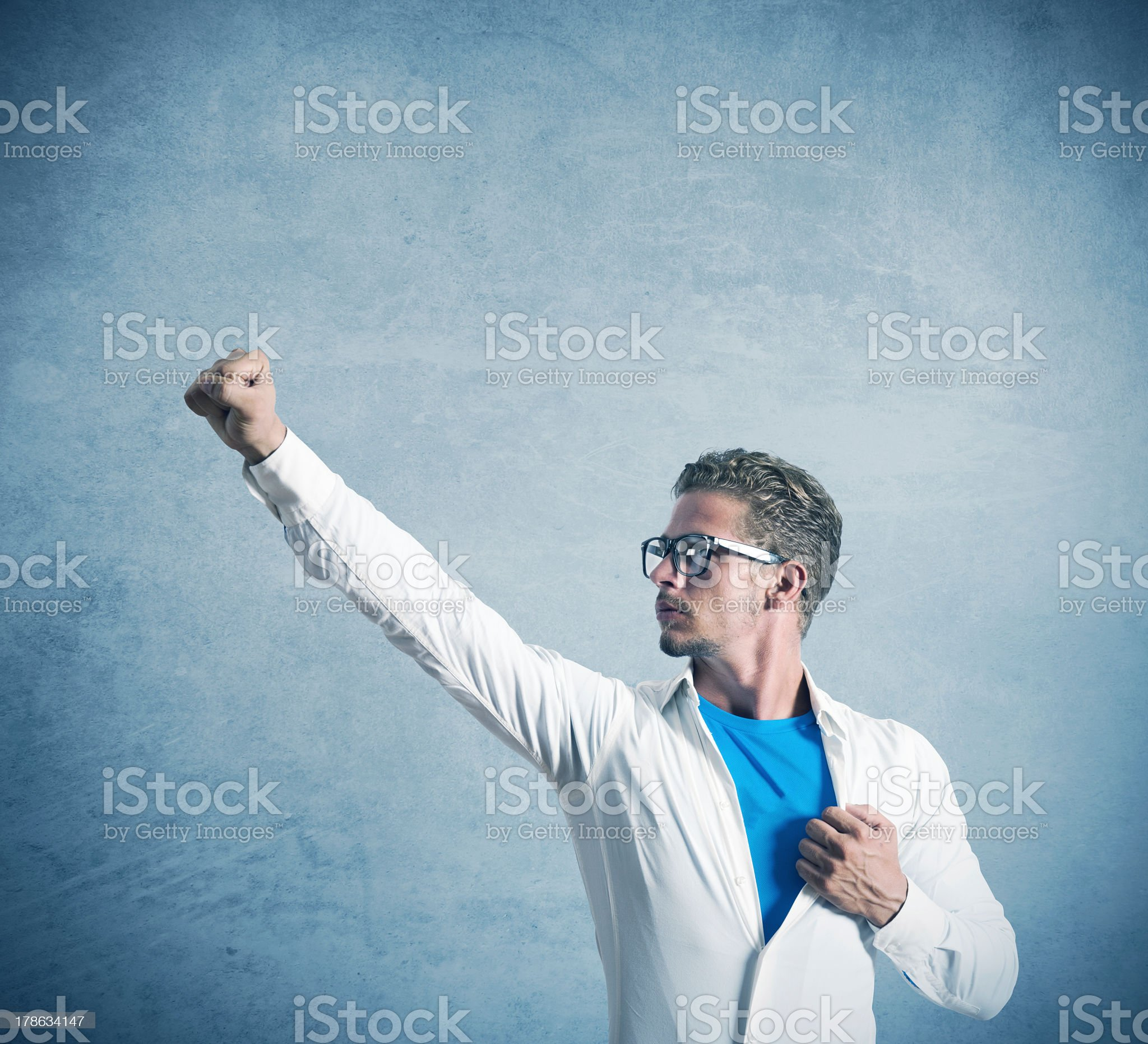 Businessman acting like a super hero royalty-free stock photo