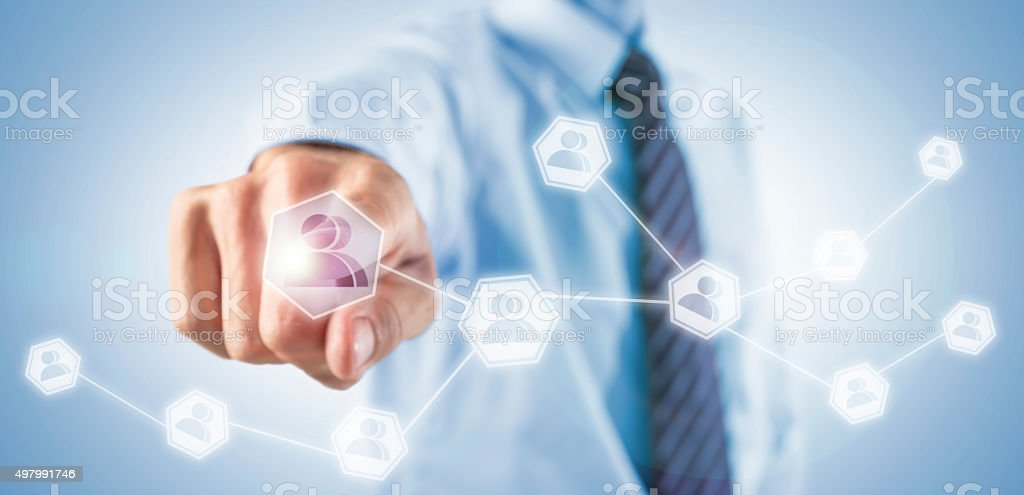 Businessman adding social friends on his network stock photo