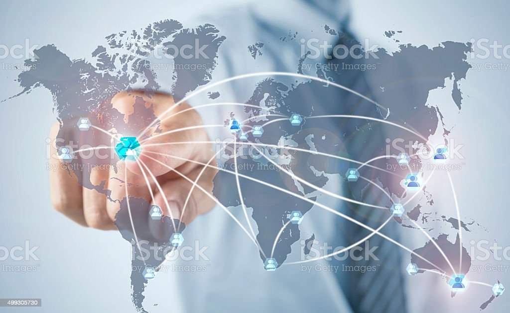 Businessman adding social friends on his world wide network stock photo