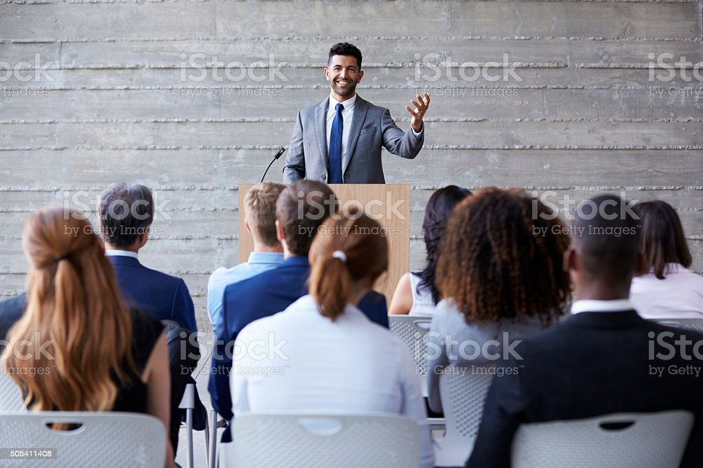 Businessman Addressing Delegates At Conference stock photo