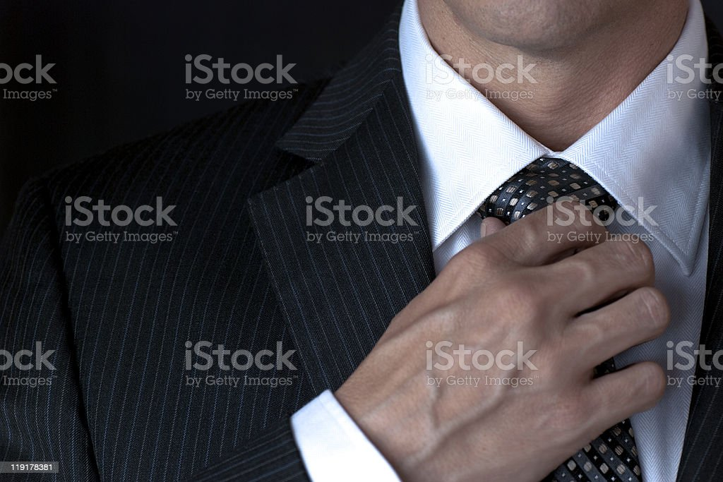 Businessman Adjusting Tie stock photo