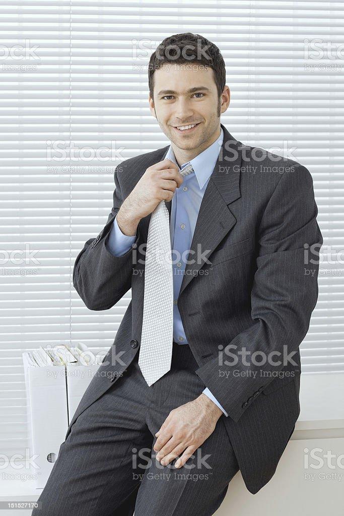 Businessman adjusting tie royalty-free stock photo