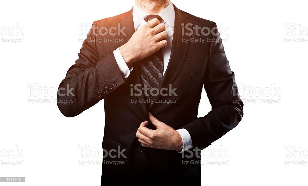 businessman adjusts his tie stock photo