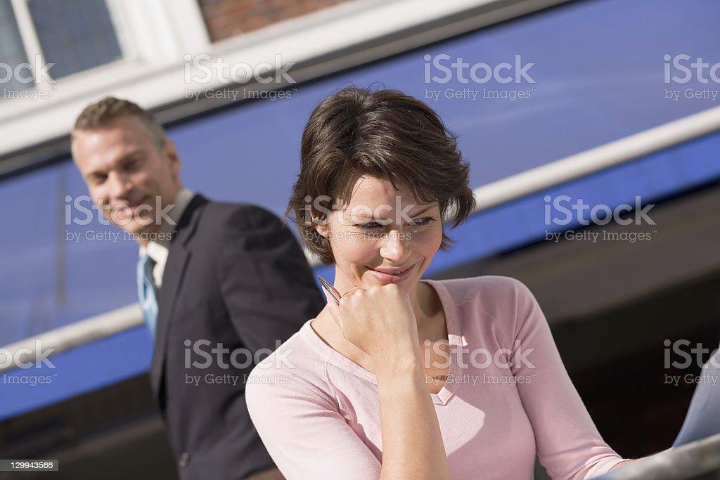 Businessman admiring female colleague royalty-free stock photo
