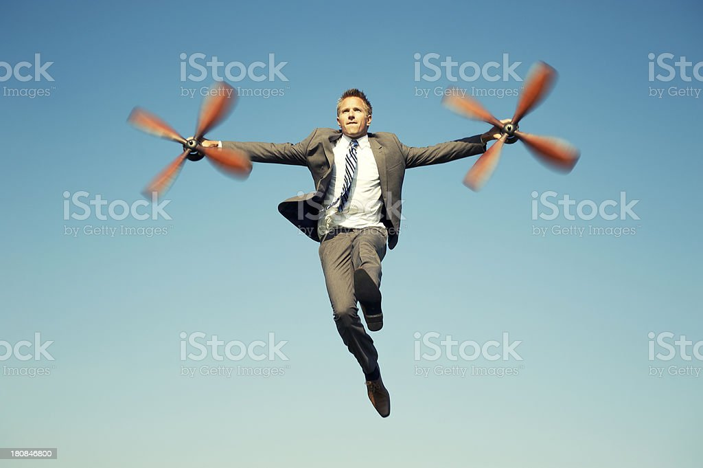 Businessman Adventurer Flying with Airplane Propellers Blue Sky stock photo