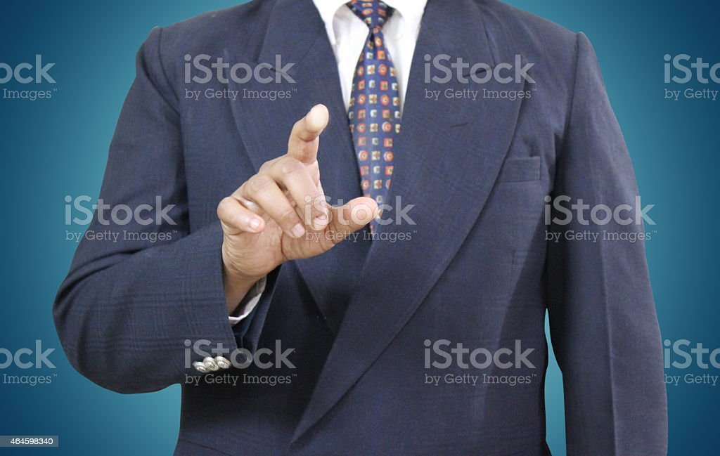 Businessman Aiming Finger at Viewer stock photo