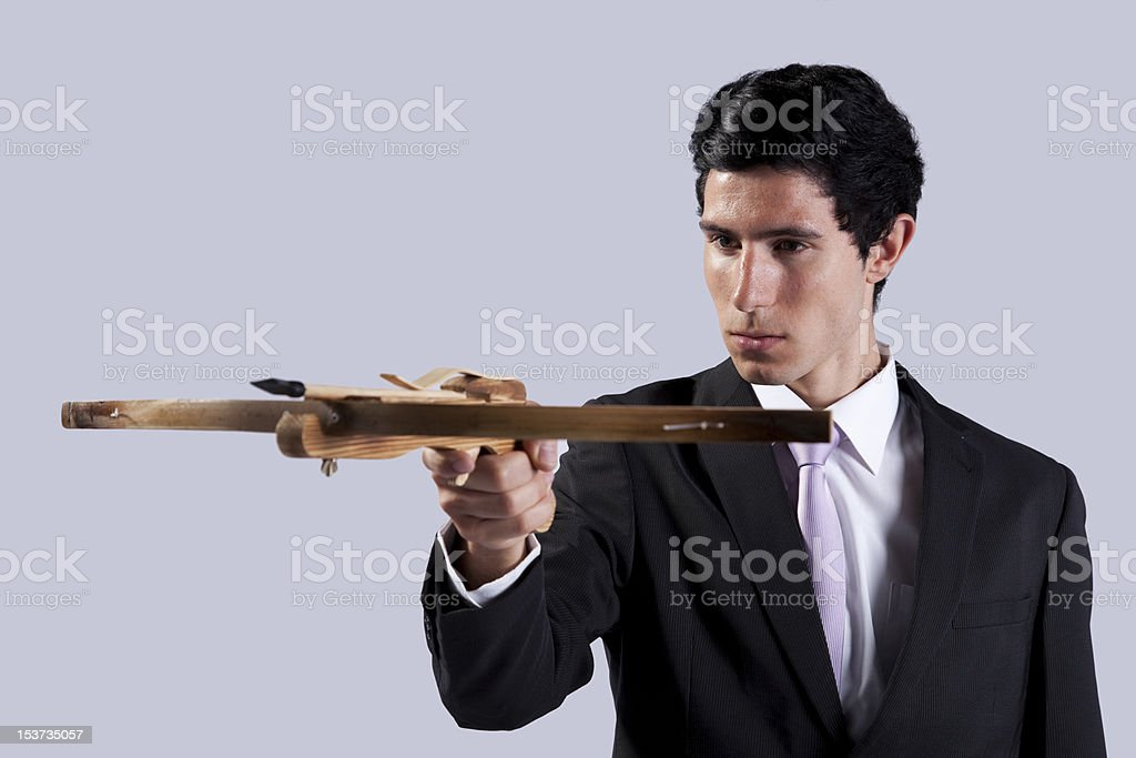 Businessman aiming with a Crossbow royalty-free stock photo