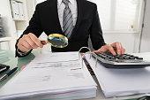 Businessman Analyzing Bills