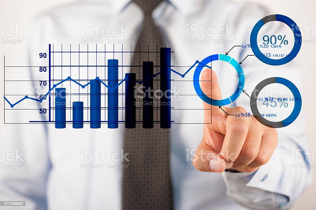 Businessman analyzing business diagrams stock photo