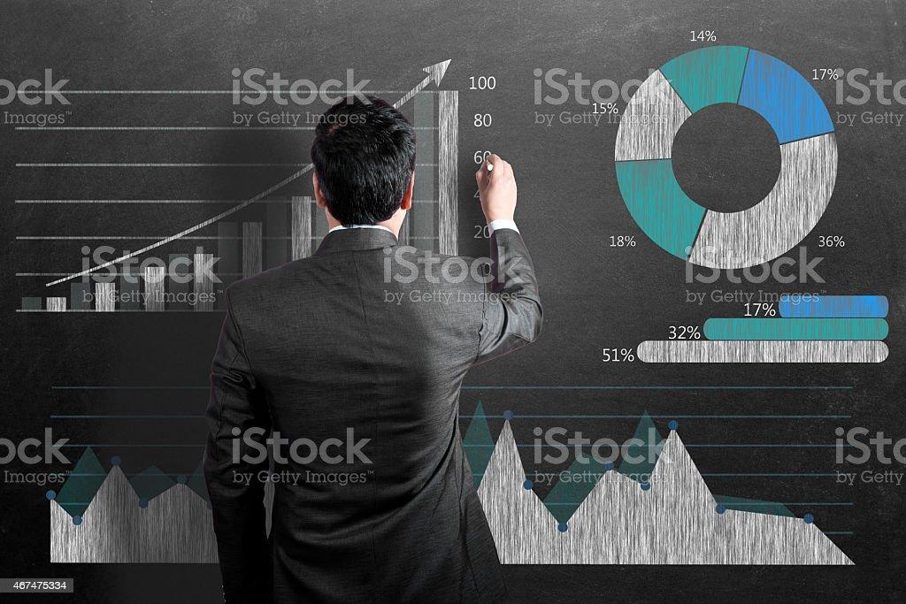 Businessman analyzing business graph stock photo