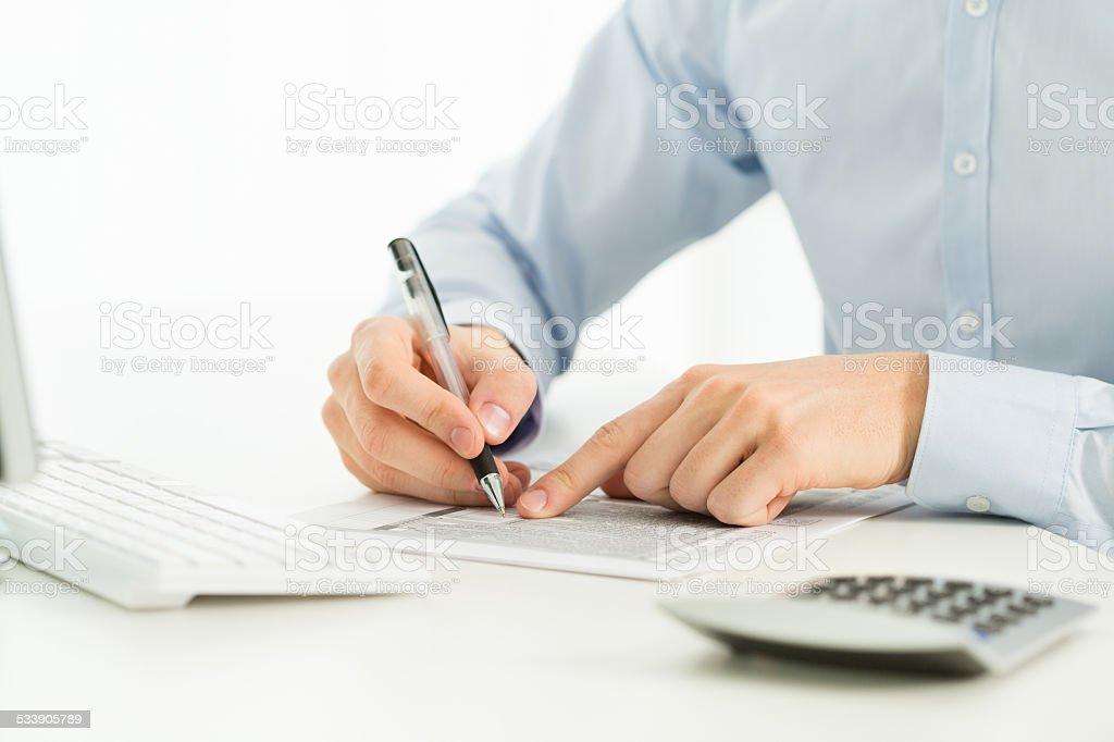 Businessman analyzing financial data stock photo