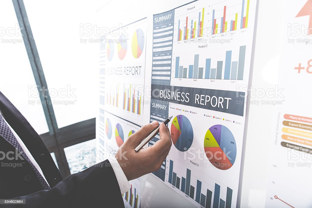 Businessman analyzing investment charts. Accounting stock photo