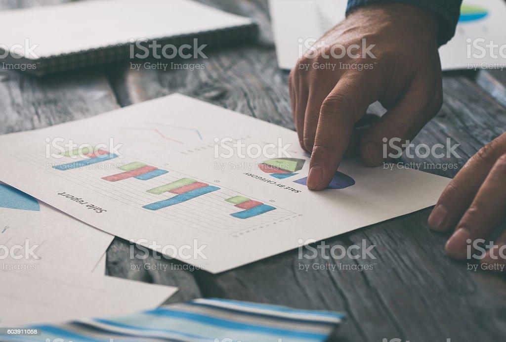 Businessman analyzing sales report stock photo
