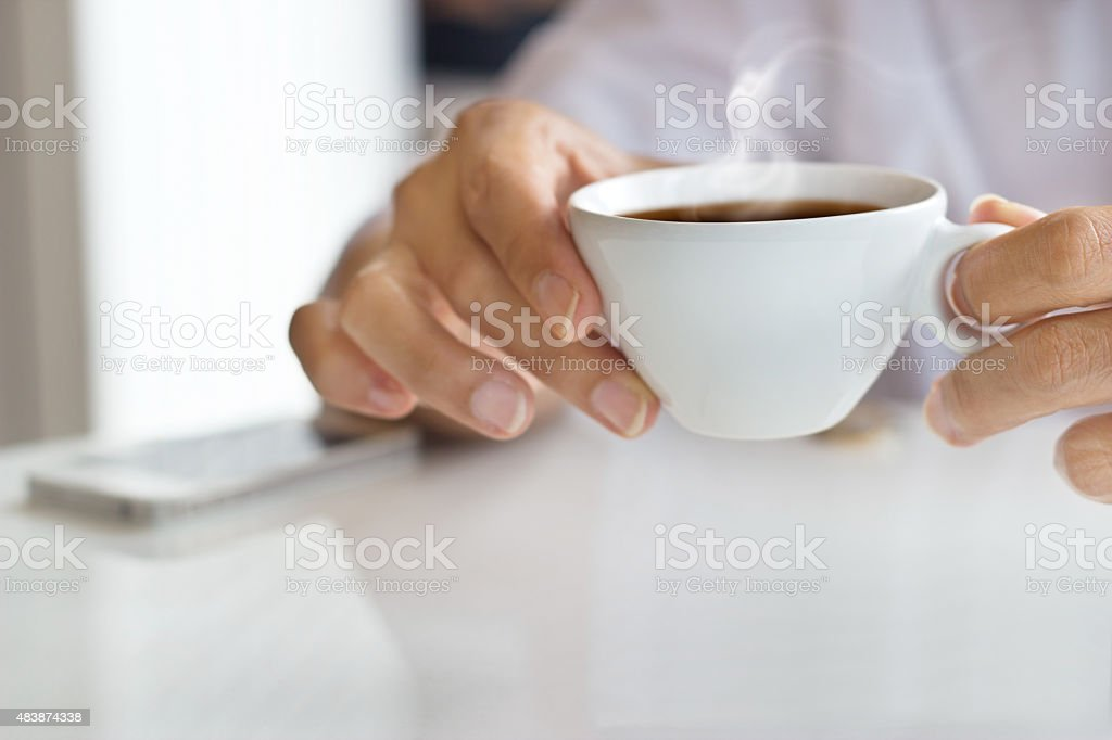 businessman and a cup of coffee in hand, blank text stock photo