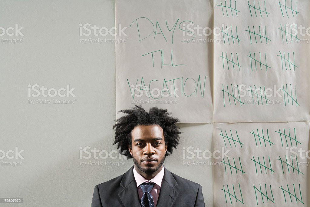 A businessman and a tally chart to his holiday stock photo