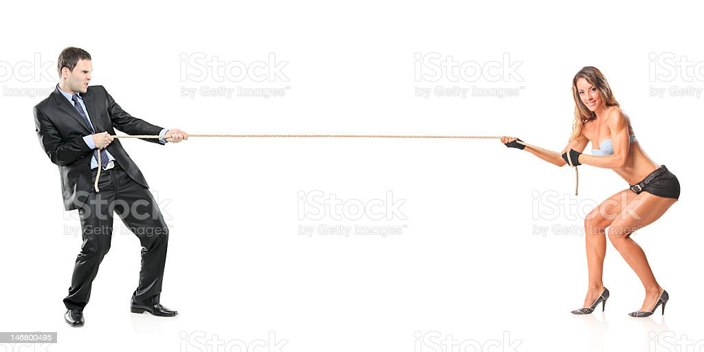 Businessman and an attractive woman pulling a rope royalty-free stock photo