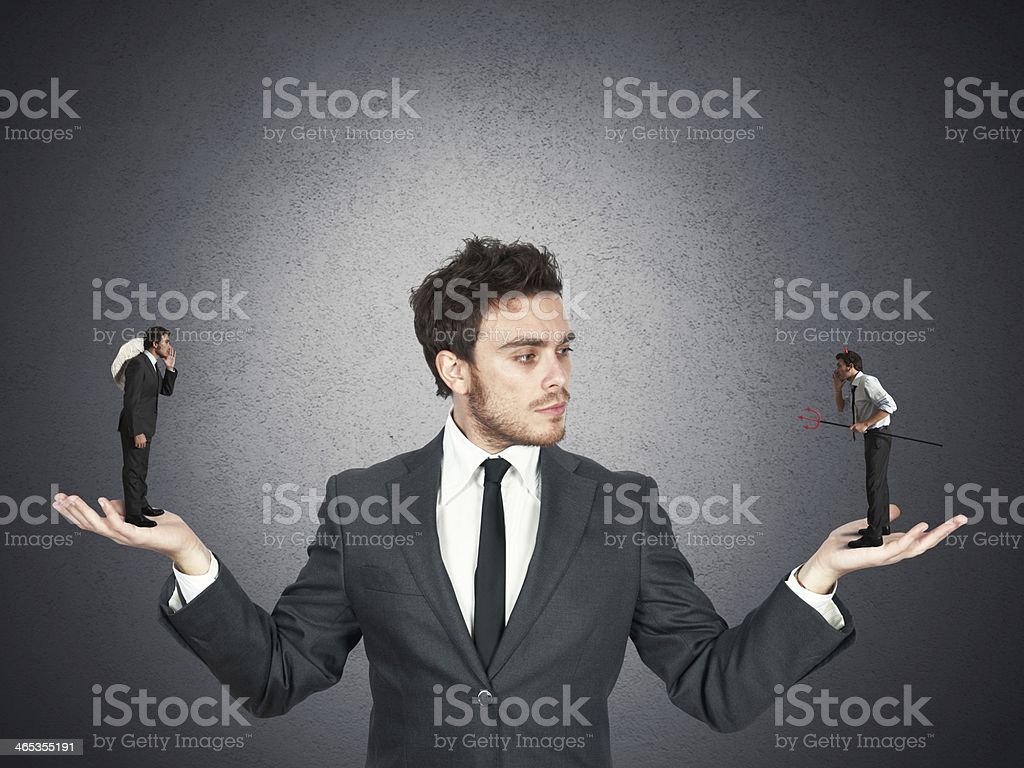 Businessman and angel or devil stock photo