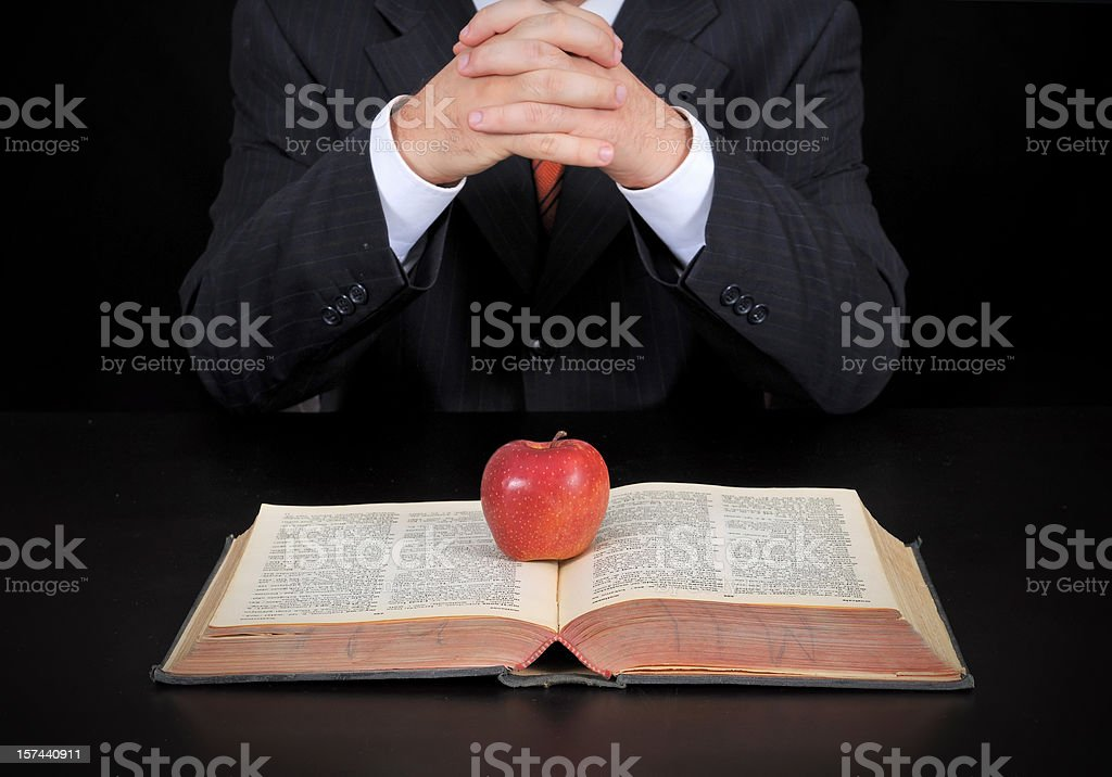 businessman and apple on the book royalty-free stock photo