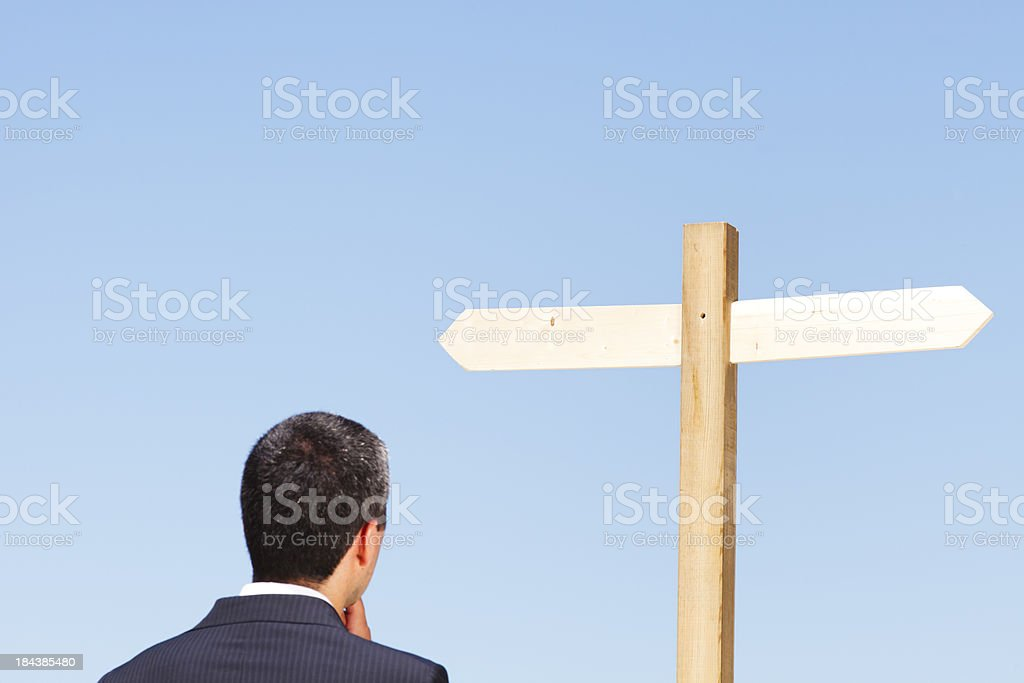 Businessman and blank directional sign post royalty-free stock photo