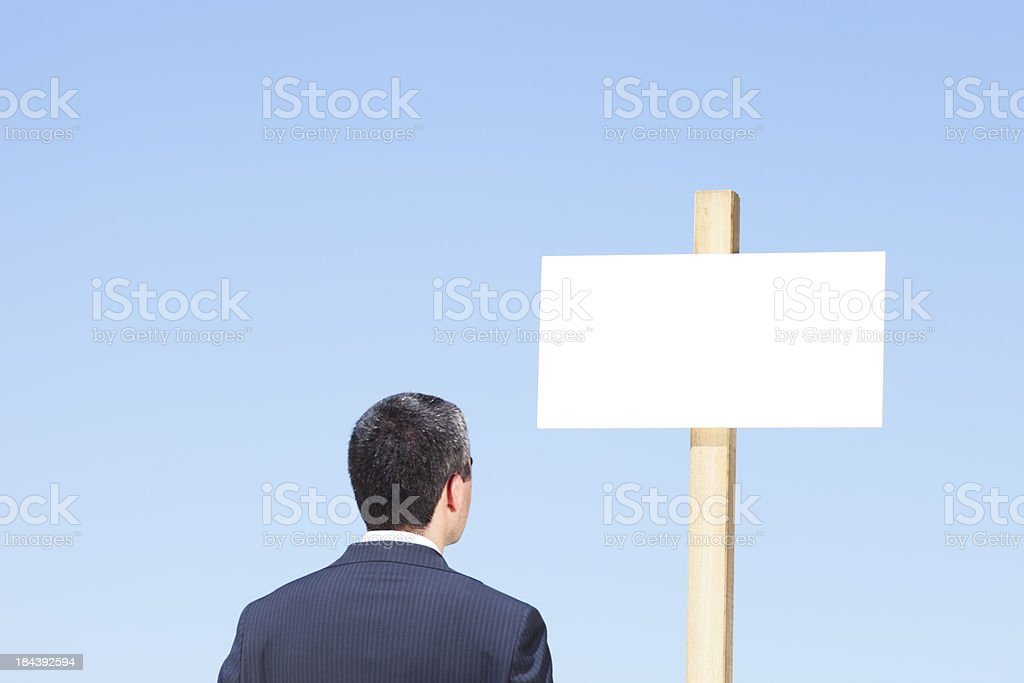 Businessman and blank sign post royalty-free stock photo