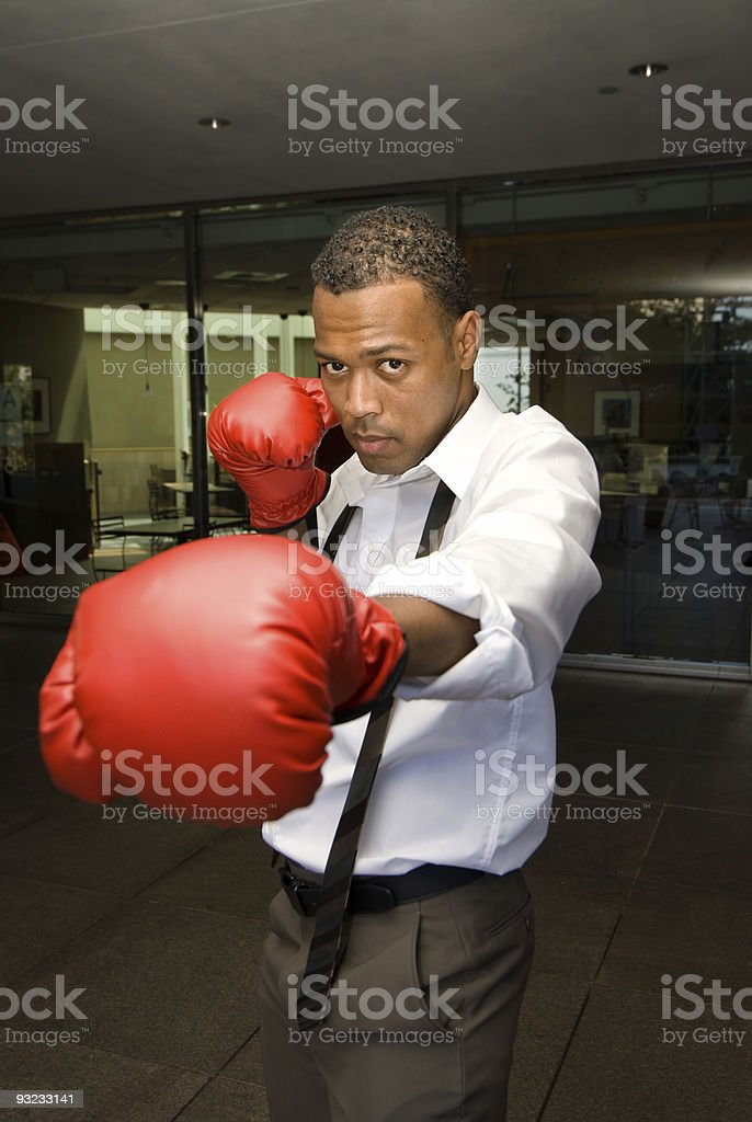Businessman and boxing gloves stock photo