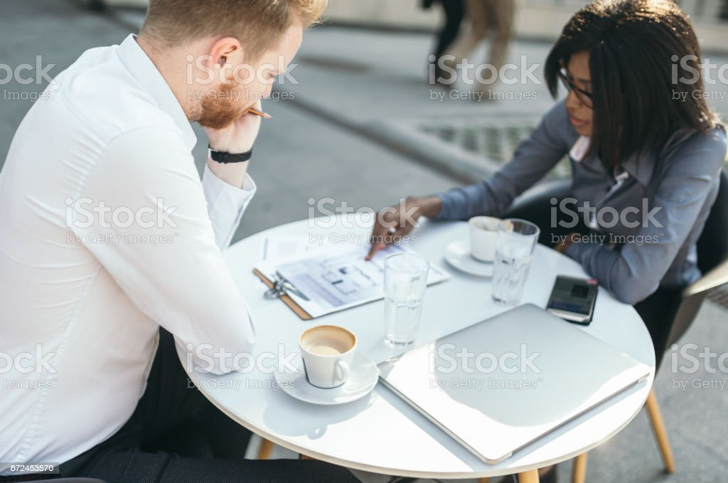 Businessman and business woman are working outdoor stock photo