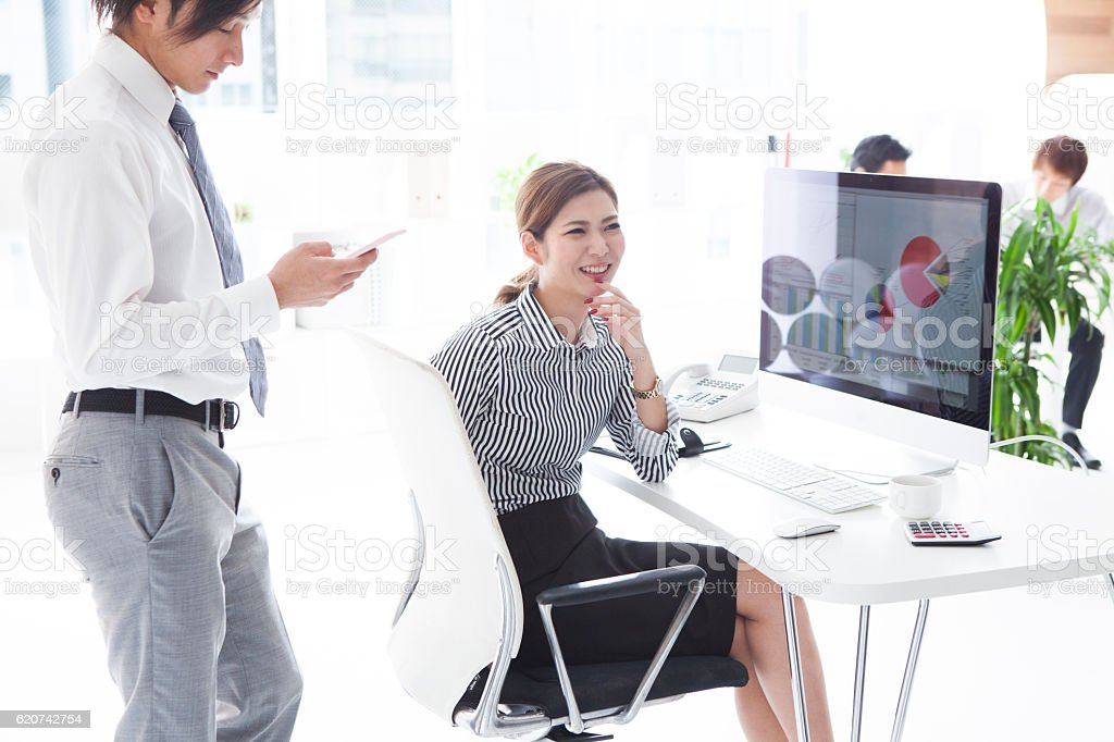 Businessman and business woman working in a modern office stock photo