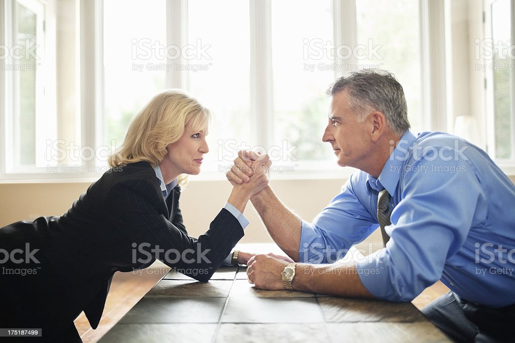 Businessman And Businesswoman Arm Wrestling stock photo