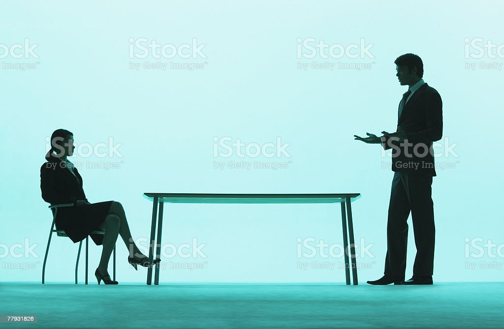 Businessman and businesswoman at a table royalty-free stock photo