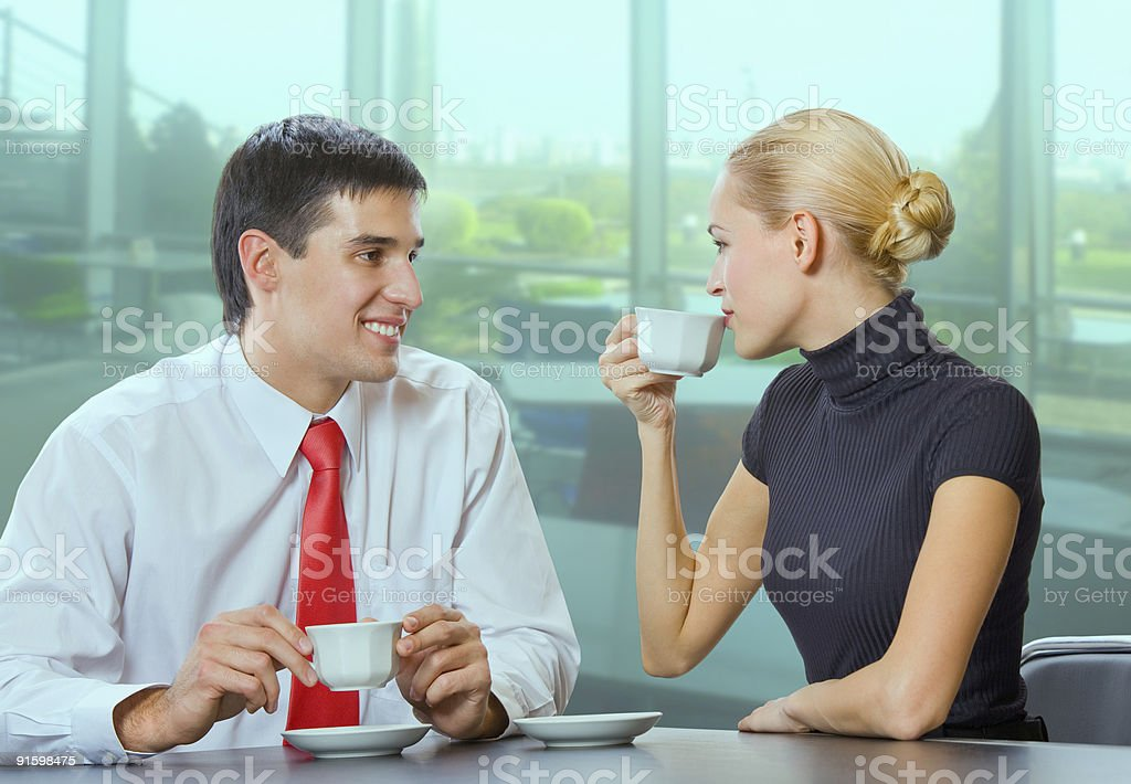 Businessman and businesswoman drinking coffee at coffee-break royalty-free stock photo