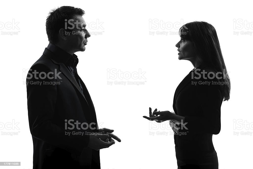 Businessman and businesswoman having a conversation stock photo