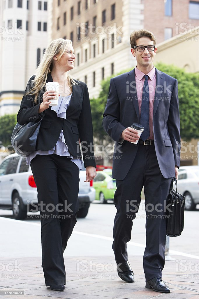 Businessman And Businesswoman In Street With Takeaway Coffee royalty-free stock photo