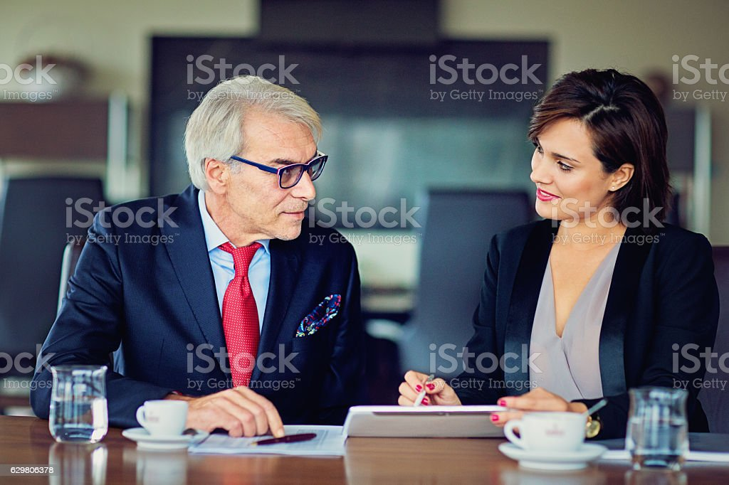 Businessman and businesswoman in the office stock photo