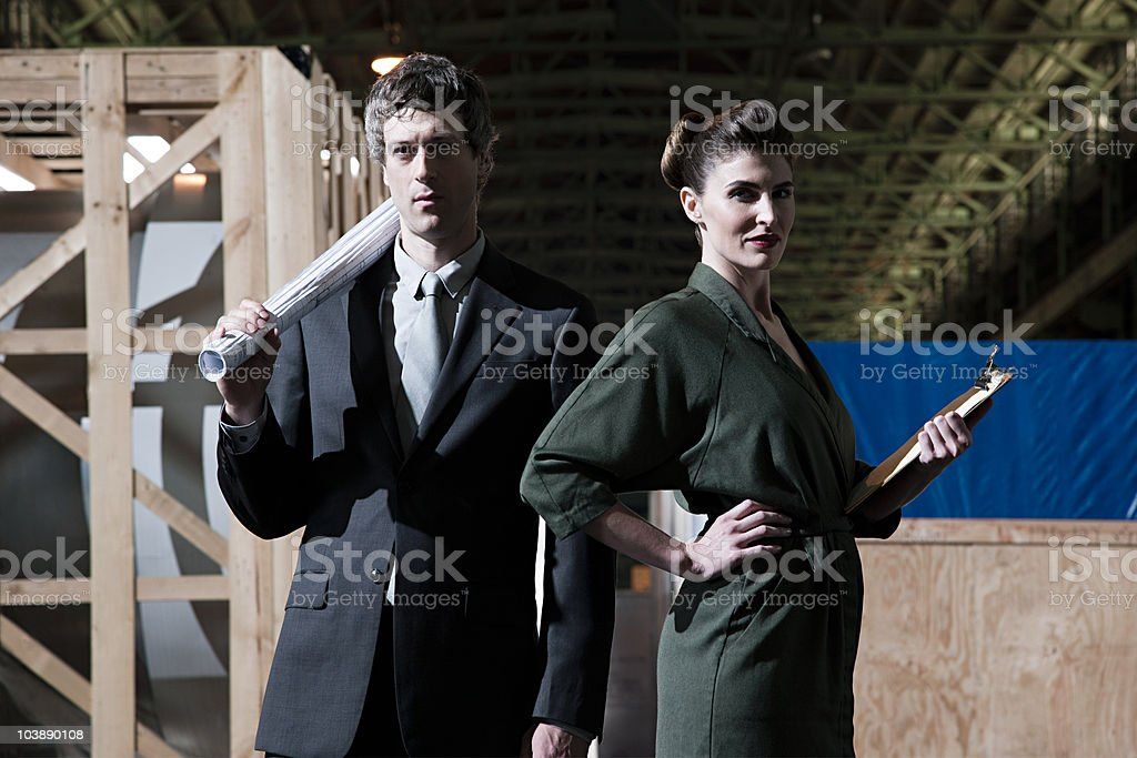 Businessman and businesswoman in warehouse stock photo