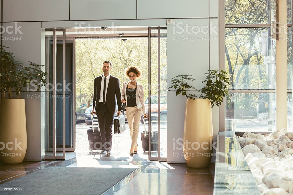 Businessman and businesswoman on business travel stock photo