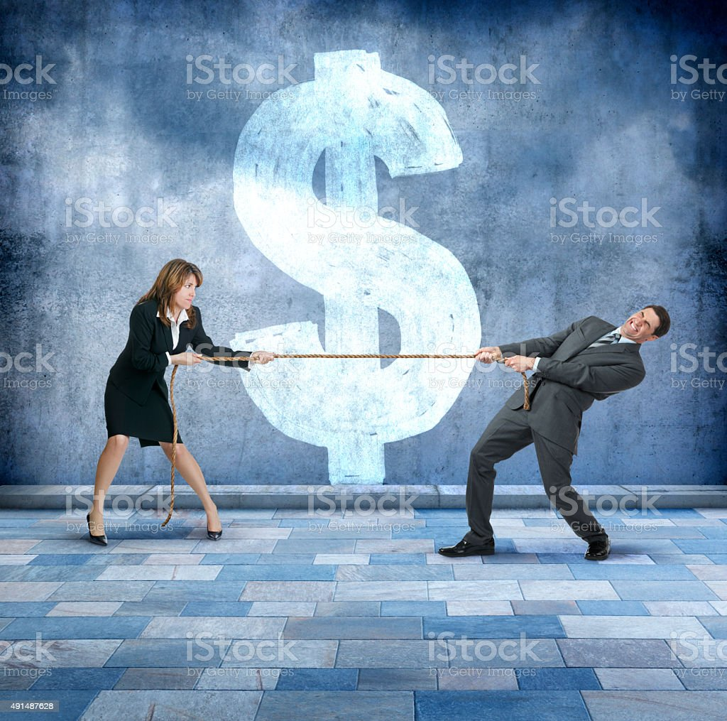 Businessman And Businesswoman Playing Tug Of War stock photo