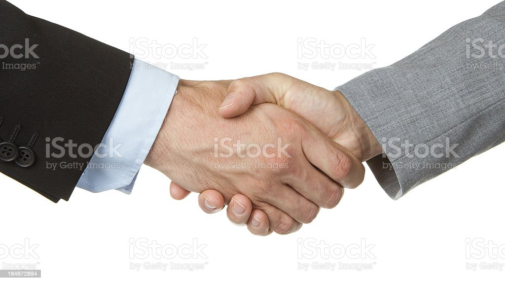 Businessman and businesswoman shaking hands royalty-free stock photo