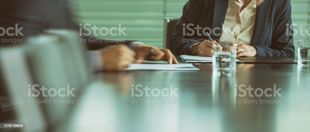 Businessman and businesswoman signing a contract stock photo