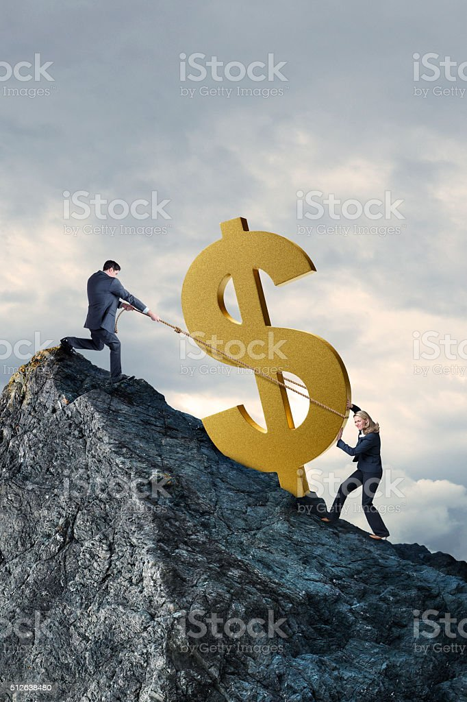 Businessman And Businesswoman Struggle To Lift Dollar Sign To Montaintop stock photo