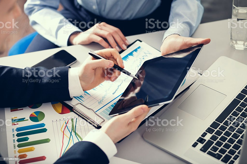 Businessman and businesswoman uses digital tablet stock photo