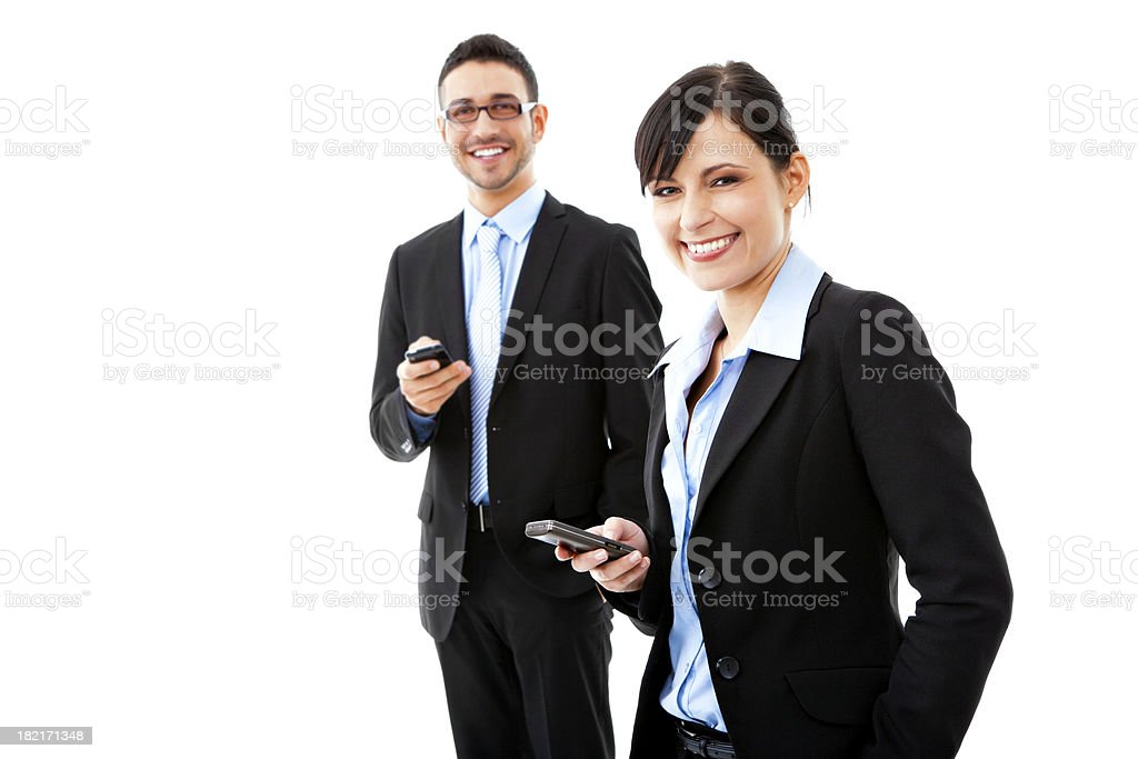 Businessman and businesswoman using mobile phones royalty-free stock photo