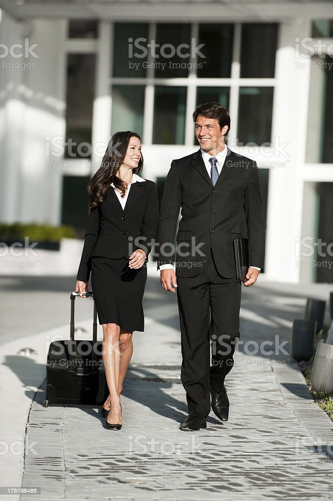 Businessman and Businesswoman Walking royalty-free stock photo