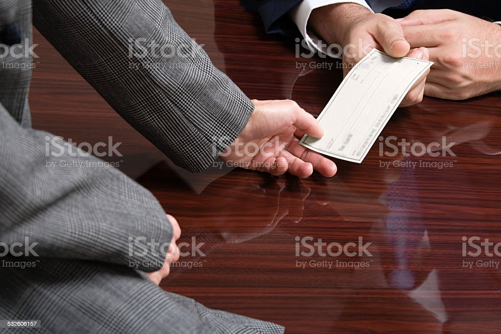 Businessman and businesswoman with blank cheque stock photo