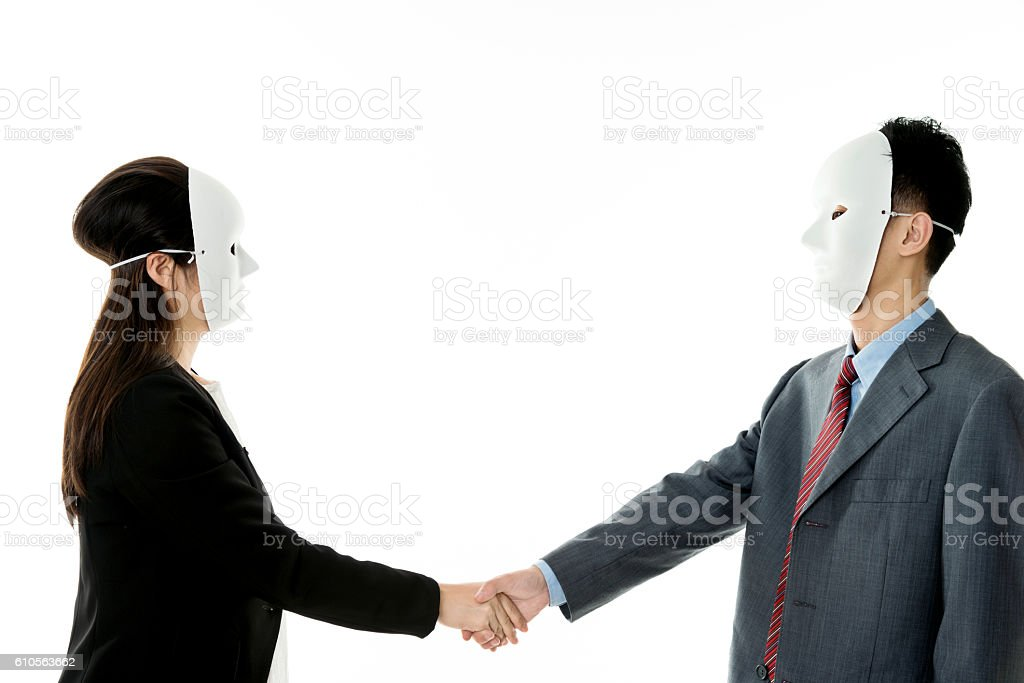 Businessman and businesswoman with mask handshake stock photo
