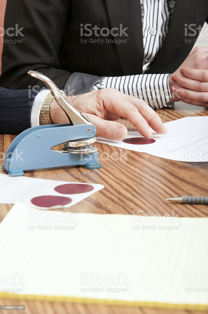 Businessman and Businesswoman with Sealed Agreement stock photo