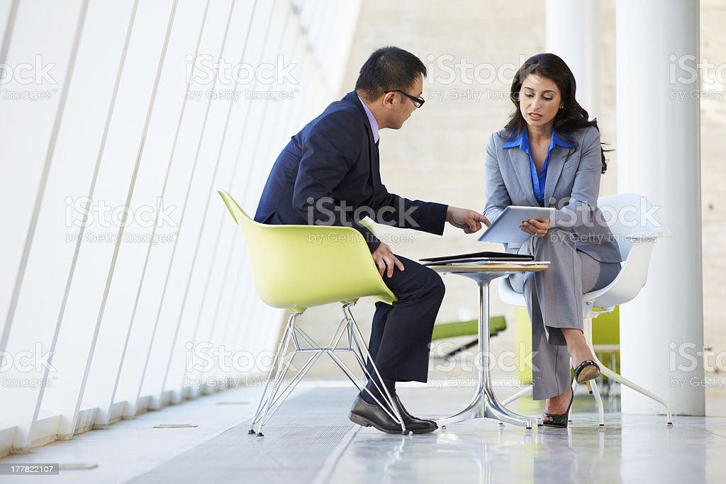 Businessman and businesswoman with tablet stock photo