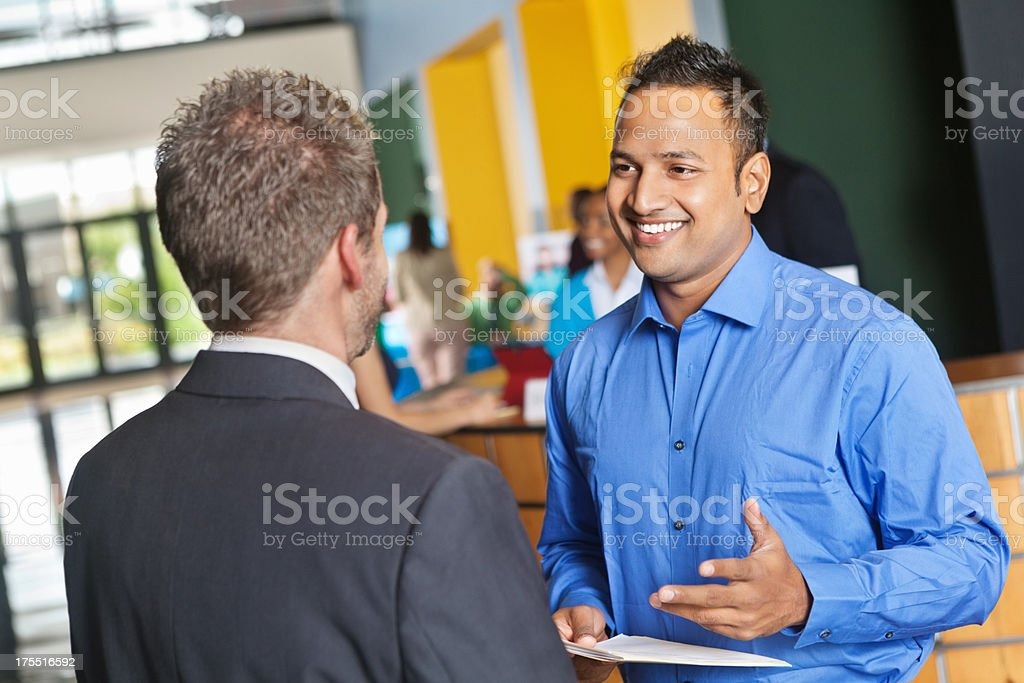 businessman and candidate talking at a recruiting job fair. royalty-free stock photo